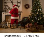 santa claus putting gifts in... | Shutterstock . vector #347896751