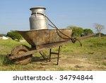 Wheelbarrow and milk churn at a farm at Cuba - stock photo