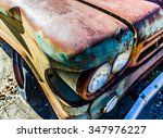 Rusty  Old  Junked Car In The...