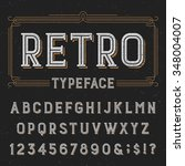 Typeset with distressed overlay texture. Retro vector typeface. Letters, numbers and symbols. Alphabet font for labels, headlines, posters etc.