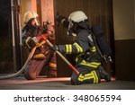 Firefighters In Action Battling ...