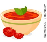 bowl of tomato soup served with ...