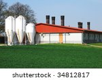 Agriculture building with white silos - stock photo
