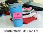 A Blue Mug With A Pink Sticky...