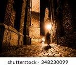 Illuminated Cobbled Street Wit...