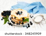 pancakes with fresh berries on... | Shutterstock . vector #348245909