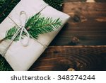 wrapped gift with fur tree... | Shutterstock . vector #348274244