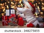 little baby in the hat of santa ... | Shutterstock . vector #348275855