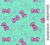 cute pattern of purple bow on... | Shutterstock . vector #348297455