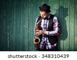 Young Man Playing On Saxophone...