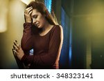 depressed young woman at the... | Shutterstock . vector #348323141