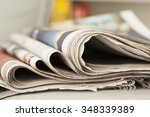 stack of newspapers on table | Shutterstock . vector #348339389