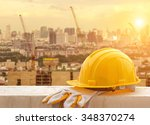 Yellow hard hat on construction site - stock photo