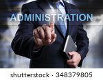 Small photo of Businessman pressing button on touch screen interface and select administration. Business, internet, technology concept.