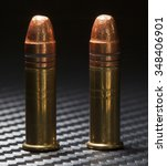 Small photo of Two rimfire cartridges used in rimfire twenty two guns