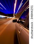 car driving fast in the night... | Shutterstock . vector #34844251