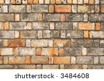 Old brick wall with varied sized and colored bricks. - stock photo