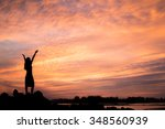 woman enjoying beautiful sunset. | Shutterstock . vector #348560939