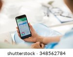 caregiver showing diet tracker... | Shutterstock . vector #348562784