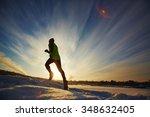 young sportsman running in snow ... | Shutterstock . vector #348632405