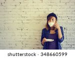 Beautiful Woman Drinking Coffe...