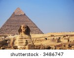 The great egyptian Sphinx of Giza with ancient pyramids on the background - stock photo