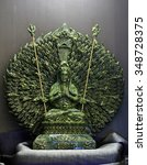 Small photo of Jade sculpture of Guanyin thousand hands, Goddess of Mercy in China.