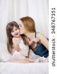 mother kissing her cute little... | Shutterstock . vector #348767351