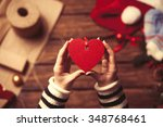 woman holding a heart shape toy ... | Shutterstock . vector #348768461