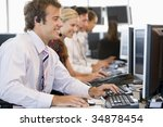 stock traders working at... | Shutterstock . vector #34878454