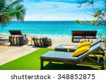 Small photo of Luxury beach chairs against the azure waters abounding the Andaman Islands , Phuket, Thailand, South Asia