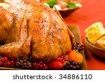 roast turkey stuffed with... | Shutterstock . vector #34886110