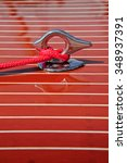 Small photo of Chrome cleat mounted on foredeck of vintage mahogany runabout boat.