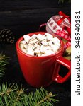 a mug of hot cocoa with... | Shutterstock . vector #348940181