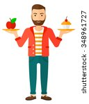 a man with apple and cake in... | Shutterstock .eps vector #348961727