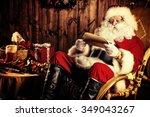 santa claus sitting at his...