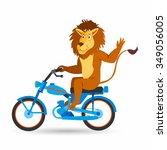 happy lion rides the bike.... | Shutterstock .eps vector #349056005