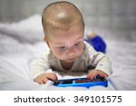 baby boy watching movie on the... | Shutterstock . vector #349101575