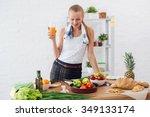 woman preparing dinner in a... | Shutterstock . vector #349133174