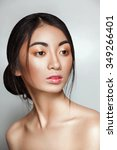 Small photo of Beautiful Asian Vietnamese woman with shiny skin Pocahontas style