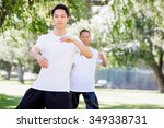 people practicing thai chi in... | Shutterstock . vector #349338731