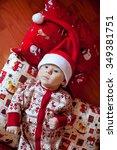 kid in christmas dress lying on ... | Shutterstock . vector #349381751