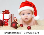 Little Baby With Santas Hat An...