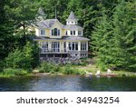 Summer home on a river - stock photo