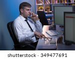 Small photo of Good boss is working after hours in his office
