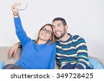 happy couple taking a photo of... | Shutterstock . vector #349728425