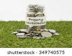 Small photo of Coins in glass jar with property investment label, financial concept. Selective focus and shallow depth of field
