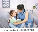 mother and daughter reading... | Shutterstock . vector #349822601