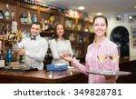 positive brunette waitress and... | Shutterstock . vector #349828781