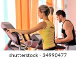 young people exercising in the... | Shutterstock . vector #34990477